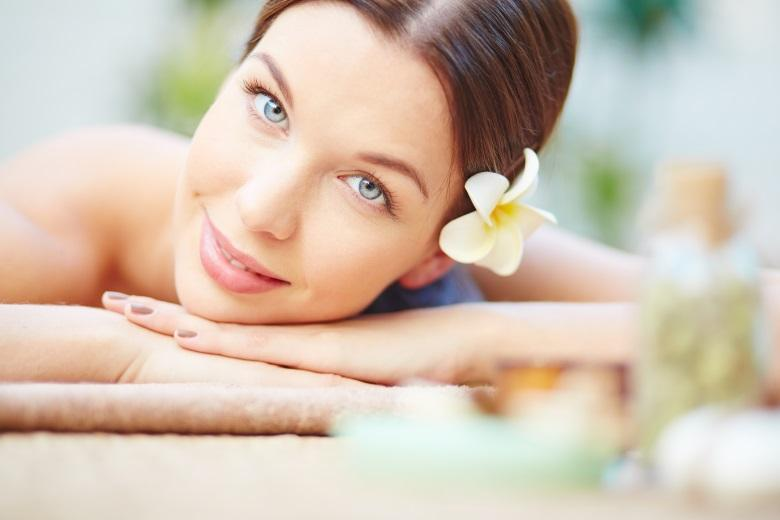 Serene girl relaxing in spa salon